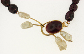 garnet, gold, and freshwater cultured pearl necklace